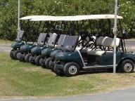 A couple drives in a golf cart rental from our company